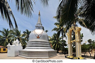 Buddhist Stupa under palm trees, Sri Lanka - Buddhist Stupa...