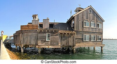 Houses on stilts, palafito, in Castro, Chiloe, Chile -...