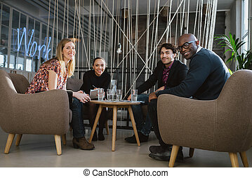 Successful business team together in office lobby