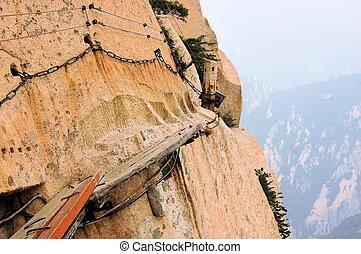 Dangerous walkway at top of holy Mount Hua Shan, China -...