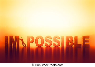 impossible - businessman pooshing big impossible text, close...