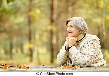 thinking senior woman - Portrait of thinking senior woman in...
