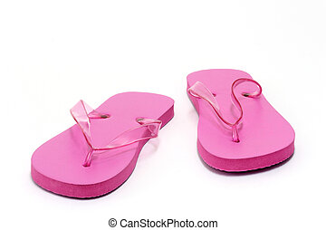 Flip Flops - Close-up of pink flip flops over white...