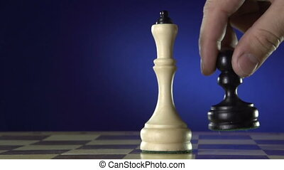 Man playing a game of chess - Conceptual image of the hand...