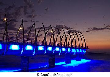 Umhlanga Pier sunrise - Sunrise over Umlanga Pier with blue...