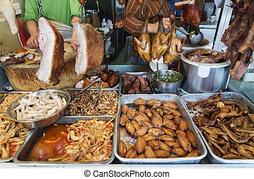 chinese meat food at butcher shop in macau street market...