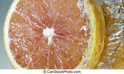 Halved grapefruit in running water - Halved healthy...
