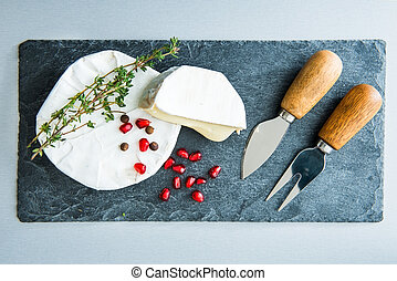 Closeup on camembert on stone substrate