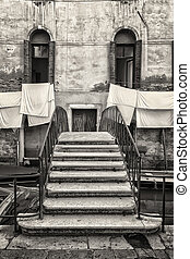 Small Traditional Staircase in front of Old Buildings in Venice