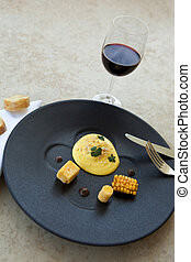 Gastronomic and creative dish - Egg with corn and polenta,...