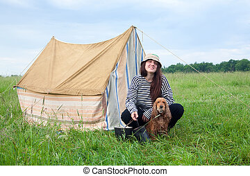 Girl with dog at camping - Young women with cocker spaniel...