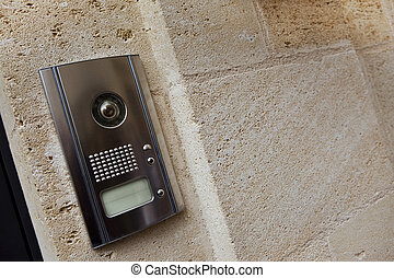 Intercom - Close up of an intercom on a stone wall