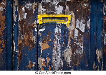 Letter box on an old painted door