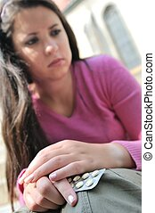 Teenager decides on taking pills - Take or not - young woman...