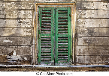 Shutter on the facade of an old French house