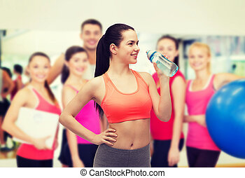 sporty woman with water bottle - sport, exercise and...