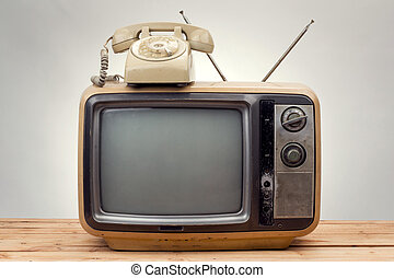 old phone and old tv vintage style on gray background