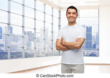smiling man in white t-shirt over office or home -...
