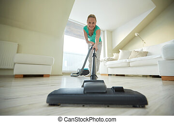 happy woman with vacuum cleaner at home - people, housework...
