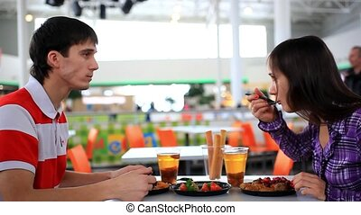 Young couple eating business lunch at cafe. HD. 1920x1080 -...