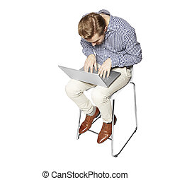 Hard work - Young man leaning over the keyboard. Isolated on...