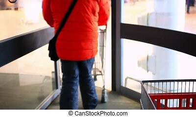 People go to the supermarket with shopping carts Close up HD...