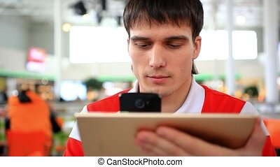 Man uses tablet in cafe, shopping online and take a picture...