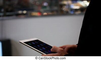 Businessmans hands using digital tablet in the shopping mall until go escalator. Close up.  HD. 1920x1080