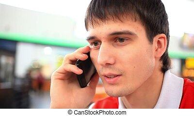 Young man talking on the phone. HD. 1920x1080 - Young man...