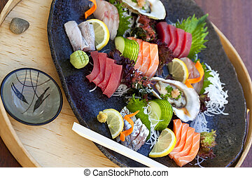 Japanese dish - Fish and raw vegetable on a Japanese plate