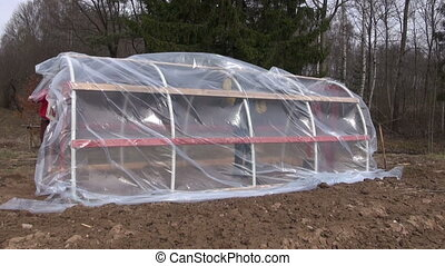 workers make new plastic greenhouse