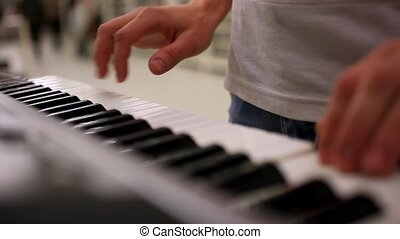 closeup of male hands playing piano Man Playing the...