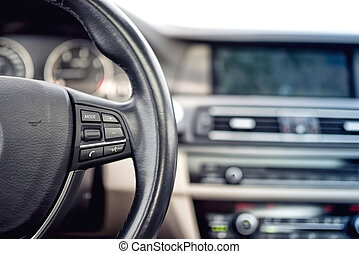 Steering wheel of modern car, details of buttons and...