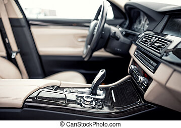 Modern beige and black interior of modern car, close-up...