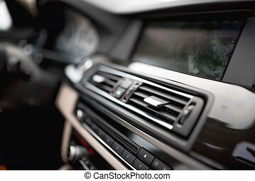 modern car interior with close-up of ventilation system...