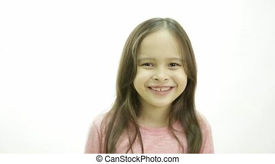 Young girl laughing expressively