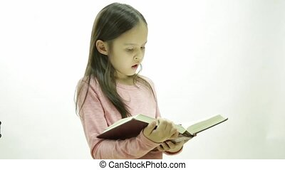 Young girl reading a thick book with various expressions