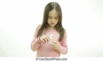 Young girl taking medicine