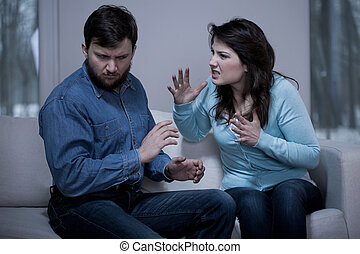 Aggressive woman - Young aggressive woman and her afraid...