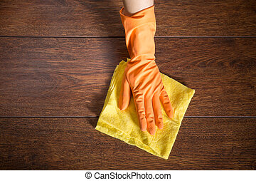 Cleaning the parquet - Close up of hand cleaning the wooden...