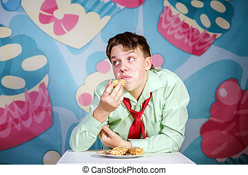 Funny boy eating sweet cakes, hungry and candy man - Funny...