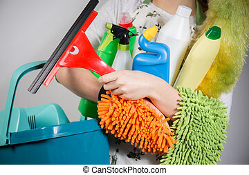 Cleaning tools - Close-up of woman holding a lot of cleaning...