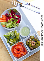 Brunch - Raw vegetable, salmon, olive and almonds for a...