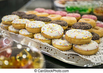 Donuts and curd balls on buffet