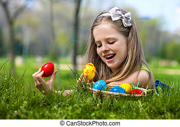 Child find easter egg outdoor. - Happy child find easter egg...