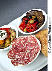 Spanish tapas - Sausage, peppers, eggplant, olives and bread...