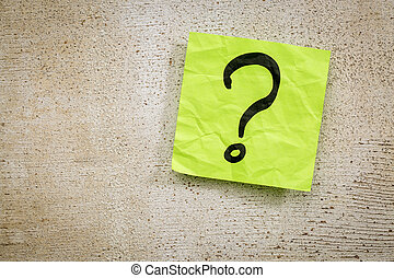 question mark on sticky note - uncertainty or doubt concept...