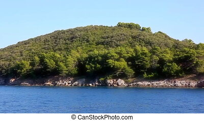 Mediterranean coastline - Passing by the coast with pine...