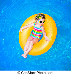 Baby girl in swimming pool - Cute funny little toddler girl...