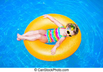 Little girl in a swimming pool - Cute funny little toddler...
